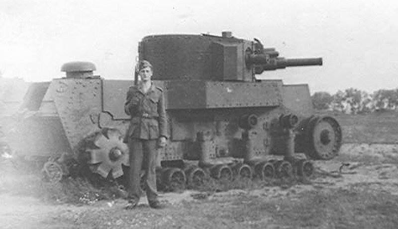A T-24 tank after preparations for use as a static pillbox. The firing system of a T-28 M1938 has been placed on the front of the turret, along with a Maxim gun instead of a DT. It also has no commander's cupola, engine, trench-crossing tail, or tracks