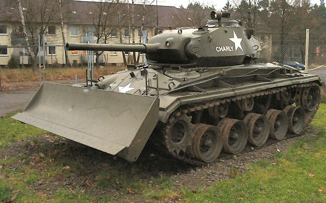 M24 Chaffee Light Tank fitted with a dozer blade.