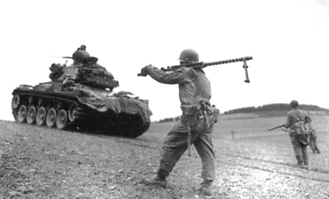 M24 Chaffee Light Tank advances towards Scharfenberg, Germany, April 1945