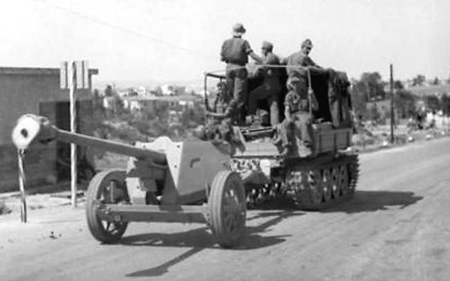 German 7.5 cm PaK 40 anti-tank gun being towed by a RSO Raupenschlepper Ost (East) Tractor, Yugoslavia, Sep 1943