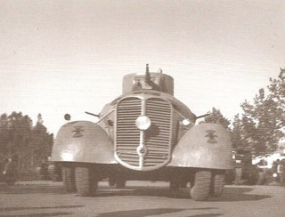 Nationalist MC-36 with a T-26 turret. Falangist markings are seen on the wheelguards.
