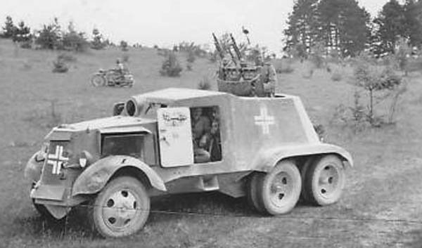 German AAC-1937 converted into a SPAAG with twin AA MG-34s. The different wheel shape and lower mudguards are the only real giveaway that this is not just a BAI.