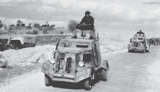 A pair of captured UNL-35s in service with the Nationalists. The engine hatches are probably open to stop the engine from overheating.