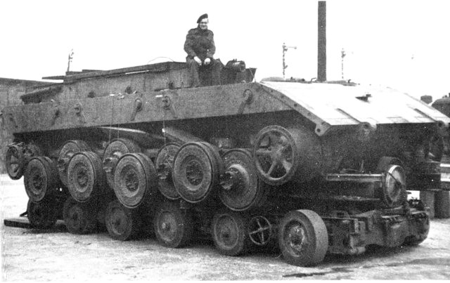 E-100 chassis on trailer, as captured by British troops in 1945