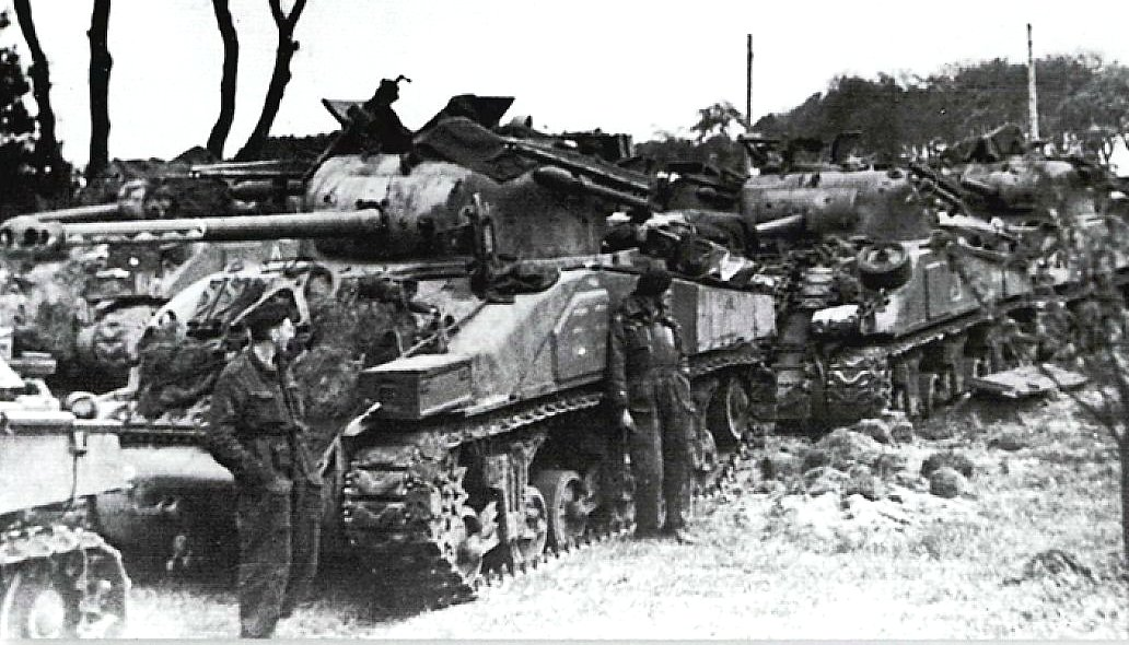 British Sherman Firefly Mk.IC Hybrid tank, 1st Armoured Battalion, Coldstream Guards, 5th Guards Armoured Brigade, Guards Armoured Division fitted with two 60 lb RP-3 (Rocket Projectile 3-inch)