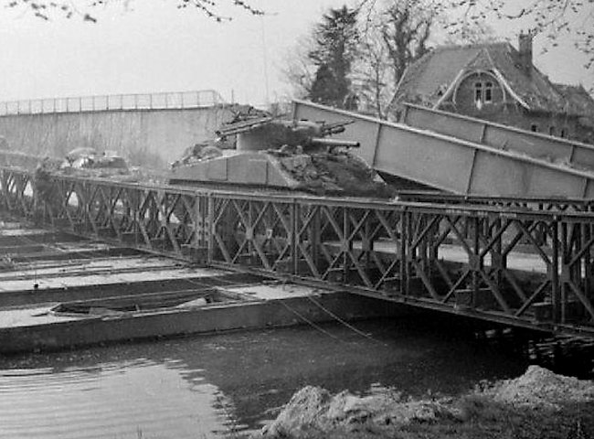 Sherman tank of the 1st Coldstream Guards, crossing a pontoon bridge over the Dortmund-Ems Canal, 6 April 1945