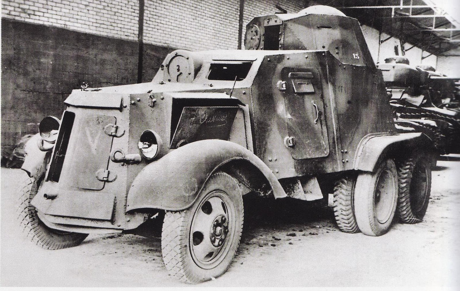 Camouflaged AAC-1937, in a storage warehouse in France. French tanks can be seen behind it. Possibly in original Republican colors.