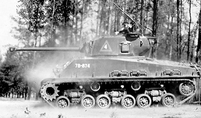 A Canadian M4A2(76)W Sherman tank firing its machine hull machine gun at Camp Petawawa training ground.