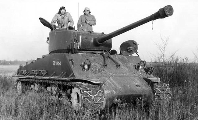 During training the gun barrel muzzle brake is covered. The tank crew are wearing padded cold weather clothing