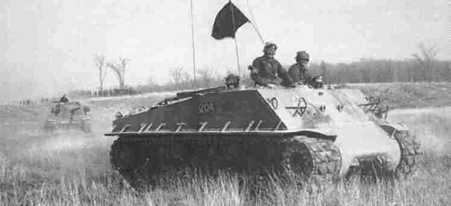Canadian Easy 8 Armoured Personnel Carrier APC being followed by a Centurion tank