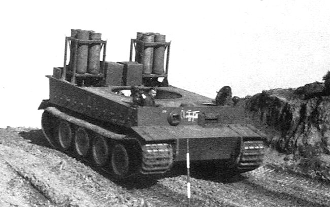 A Tiger tank chassis converted to run on the Holzgas system. The wood burner combustion unit is in the middle at the rear and it is flanked on each side by the vertical gas storage and cooling cylinders.