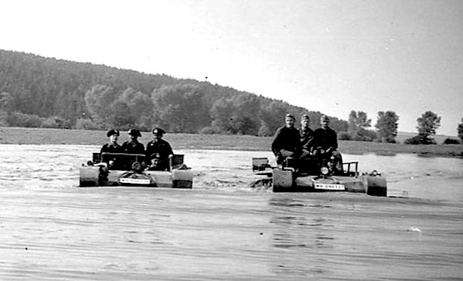 A group of Fahrschulepanzerwagen I Ausf.As fording a shallow lake or river.