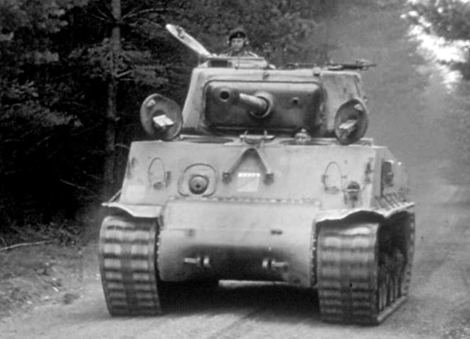 Canadian M4A2(76)W Sherman tank driving along forest tracks in Camp Petawawa Training Ground in 1963