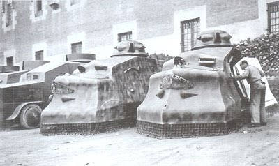 Possibly a late type Constructora Fields next to other unknown improvised vehicles.