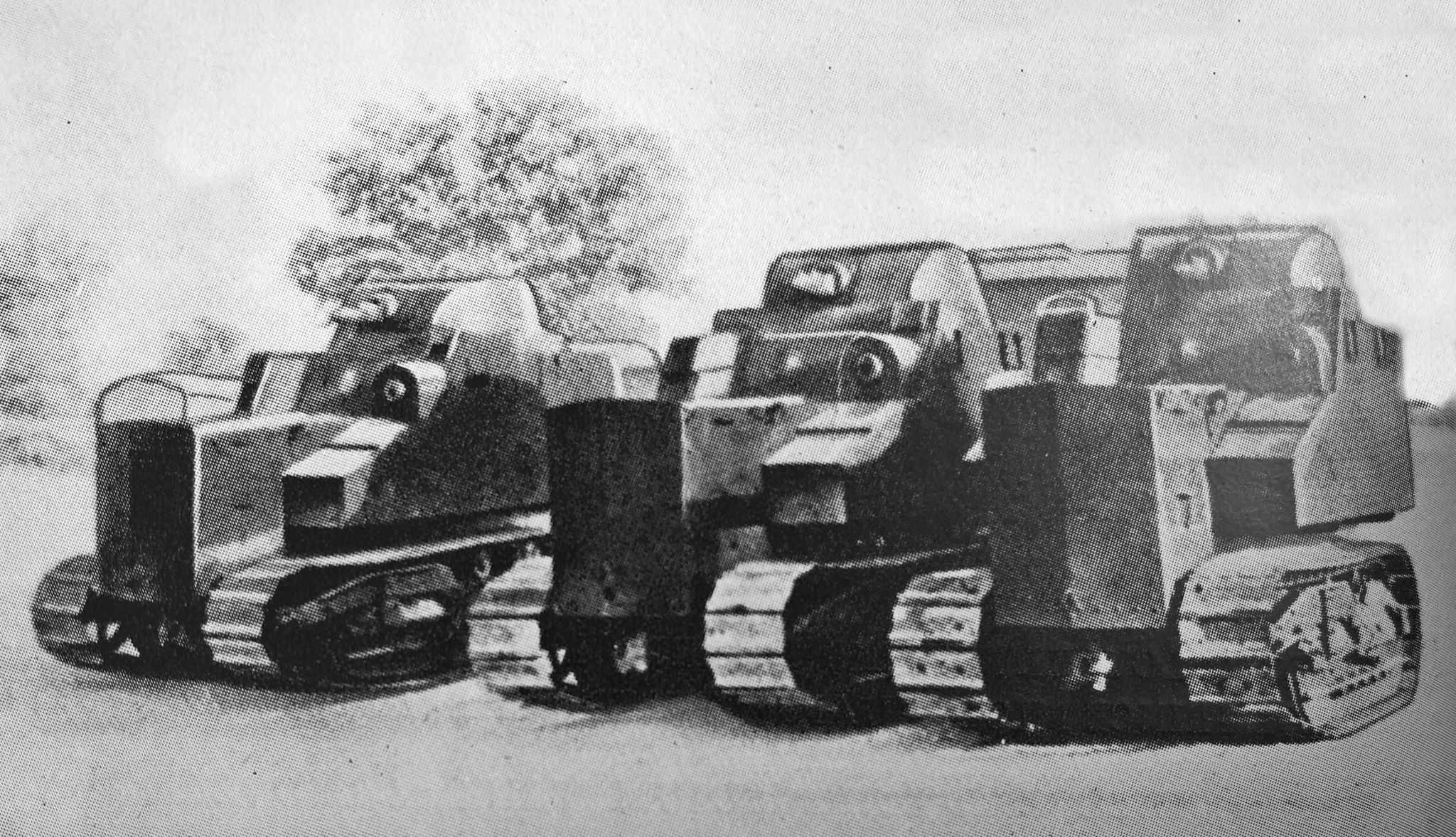Poor quality photo of several Disston Tractor Tanks. Their exact hull shapes appear slightly different to one another