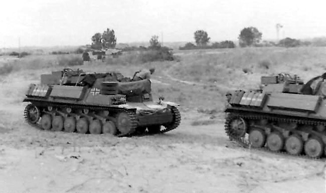Notice the spare road wheels strapped to the top of the right track guard of this Bison II