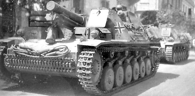 German 15 cm sIG 33 auf Fahrgestell Panzerkampfwagen II (Sf) parked in a North African street.