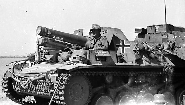 The driver's side vision hatch is open on this photograph of a 15 cm sIG 33 auf Fahrgestell Panzerkampfwagen II (Sf)