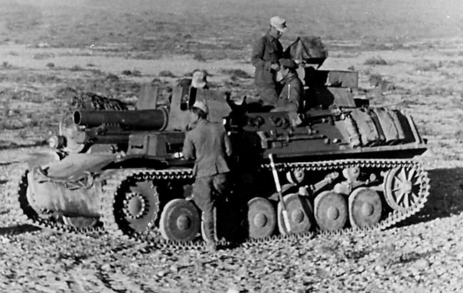 Notice the stick leaning on the vehicle. It was painted red and white and hammered into the earth behind the vehicle to help the gunner work out firing angles.