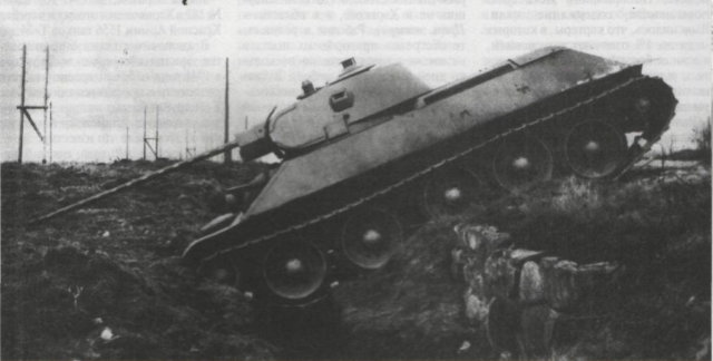 The T-34/57 prototype during obstacle trials. The gun, which very nearly touches the ground, is level with the tank, or a 0 elevation - Credits: Central Archive of the Russian Ministry of Defense