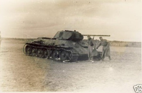 A subtly different type of T-34, with a welded turret, the early track and the early driver vision hatch