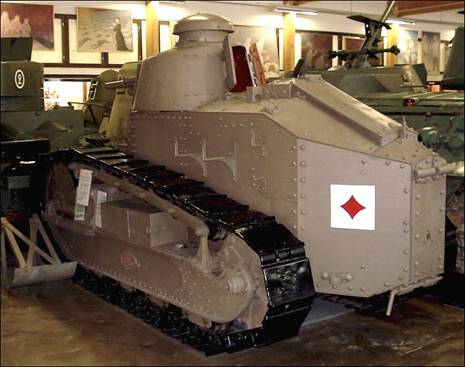 The Renault FT's engine was at the rear of the vehicle. The skid that is normally fixed to the back of the tank has been removed and placed on the ground next to the tank.