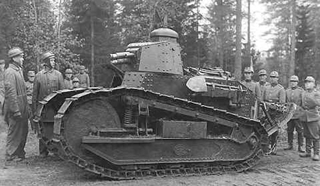 Finnish Army tank crew showing their Renault FT Tank to the infantry