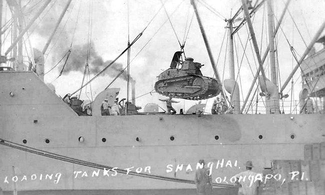 Loading US Marine Corps M1917 tanks on ships for transportation to Shanghai, China 1927