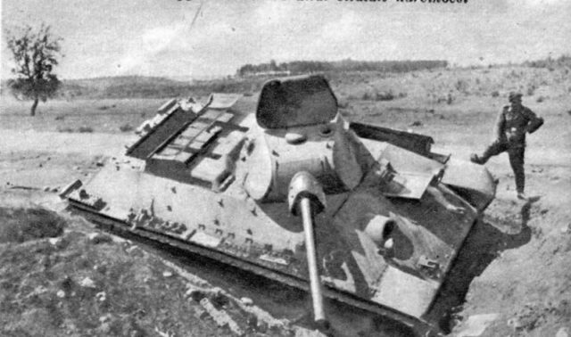 A German soldier posing with an abandoned T-34 which might be an Exterminator