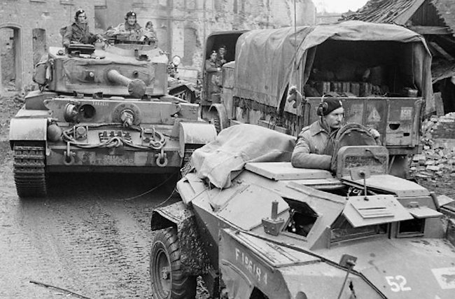 3rd Royal Tank Regiment A34 Comet tank driving behind a regimental HQ Humber scout car in Germany, 1945