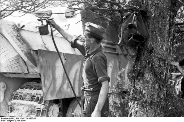 German soldier spray painting camouflage paint over Zimmerit