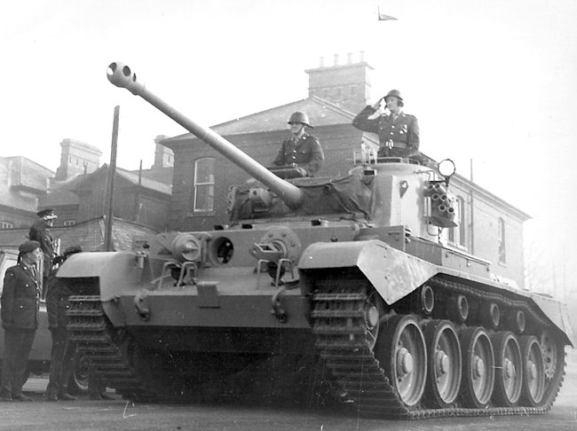 Irish Army Comet tanks were painted light gray. This is a post-war type B Comet. Smoke dischargers have been fitted to the side of the turret.