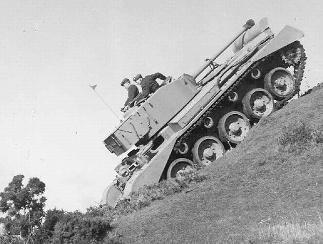 Irish Army Comet tank with the gun facing the rear in the locked position between the gap in the double Normandy exhaust cowlings