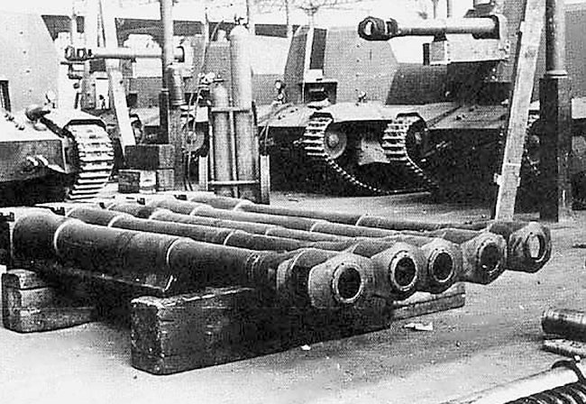 10.5cm leFH 16 gun barrels awaiting hoisting into the new gun mounts on top of the modified FCM 36 tanks