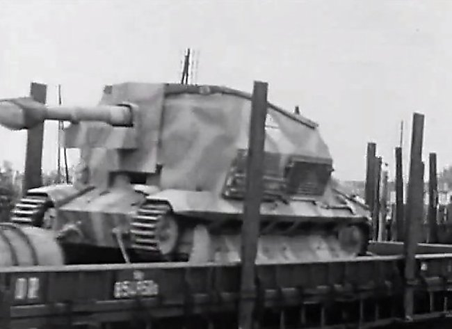 10.5cm leFH 16 auf GW FCM 36(f) SPG being transported by rail to the front line.