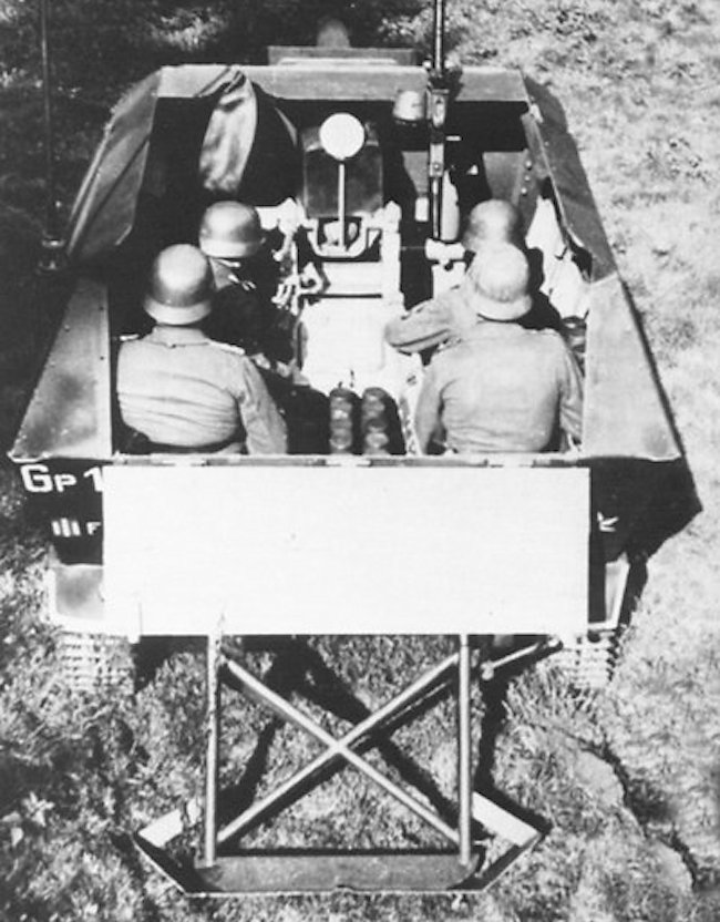 The driver would sit behind the loader on the right, at the back, when the gun was fired to assist with loading the gun.