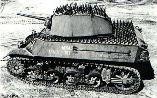M3A3 Stuart tank fitted with spiked armor on horizontal surfaces and the Trucson coating