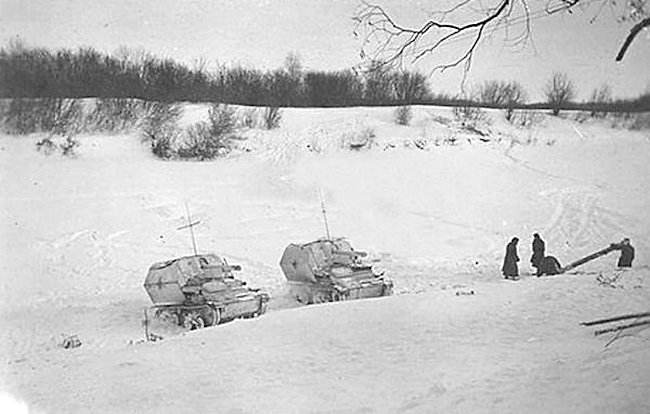 Two 10.5cm LeFH 16 auf Geschutzwagen Mk.VI(e) SPGs in a revers slope firing position to avoid detection from the Soviet troops