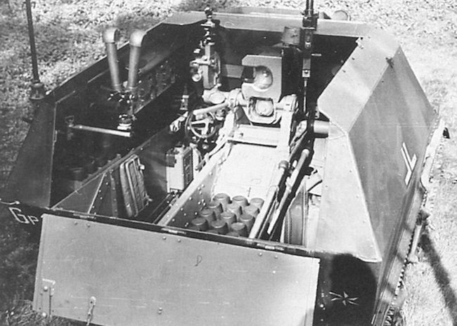 Fighting compartment showing the commander's and gunner's positions on the left of the SPG