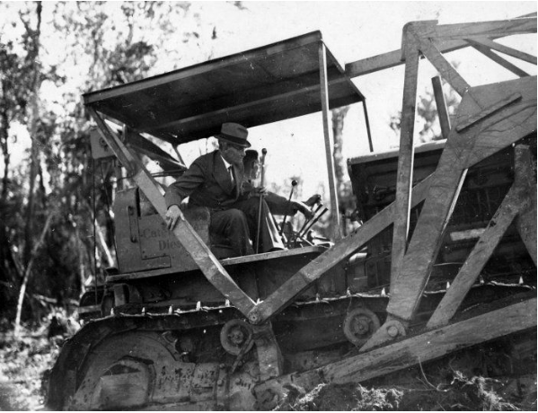 Robert Semple (cane in hand), then Minister of Works, on a Caterpillar diesel bulldozer, 29th of March 1939