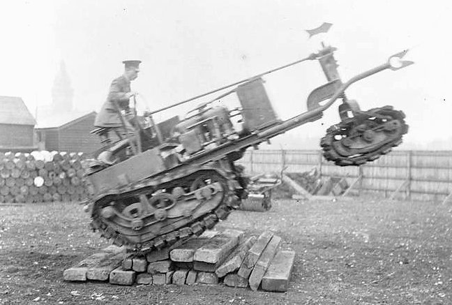 Killen-Strait Tractor at Armoured Car Headquarters at the Clement Talbot Works, Barlby Road, Wormwood Scrubbs. Summer 1915. Note torpedo wire-cutter.