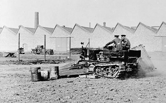 Experiment with Killen-Strait Tractor at R. N. A. S. Armoured Car Division H. Q., Wormwood Scrubbs, June 1915.