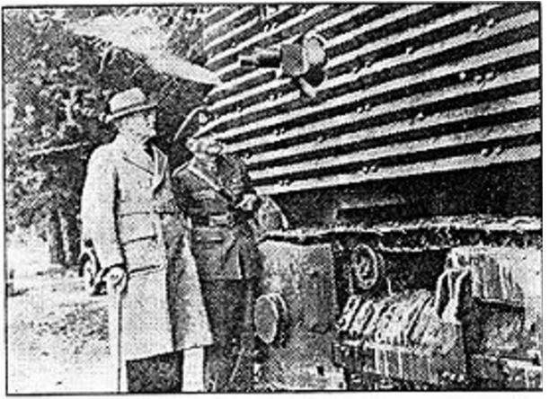 Robert Semple (with cane) accompanied by unidentified staff officer inspecting the very tall sides of the PWD tank