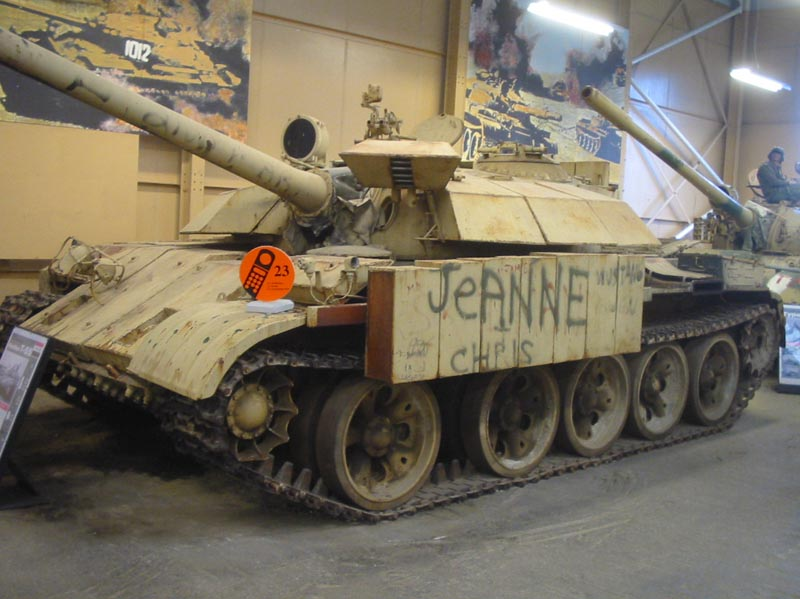 T-55 Enigma Jeanne Chris at the Bovington Tank Museum. The armor box above the driver's hatch has been lifted up, which the driver would need to do to get in and out of the vehicle.