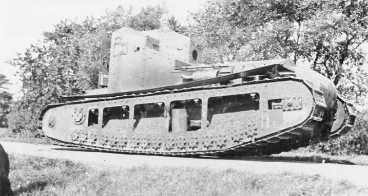 Rebuilt Tritton Chaser with a rudimentary canvas track guard fitted presumably in an attempt to limit the amount of mud being thrown up onto the vehicle. Machine gun ports have been cut but no armament is fitted. Photo: IWM
