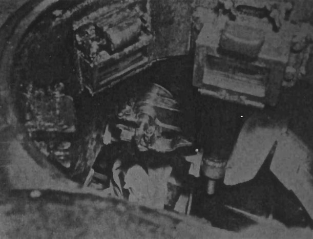 A photo taken through the commanders hatch, showing the breach of the 120 mm width=