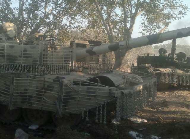 T-72 Mahmia, probably from the same batch as the above. It shows signs of battle damage, or, more likely, careless driving, as it is missing some chains, and the cages and fenders are bent out of shape.