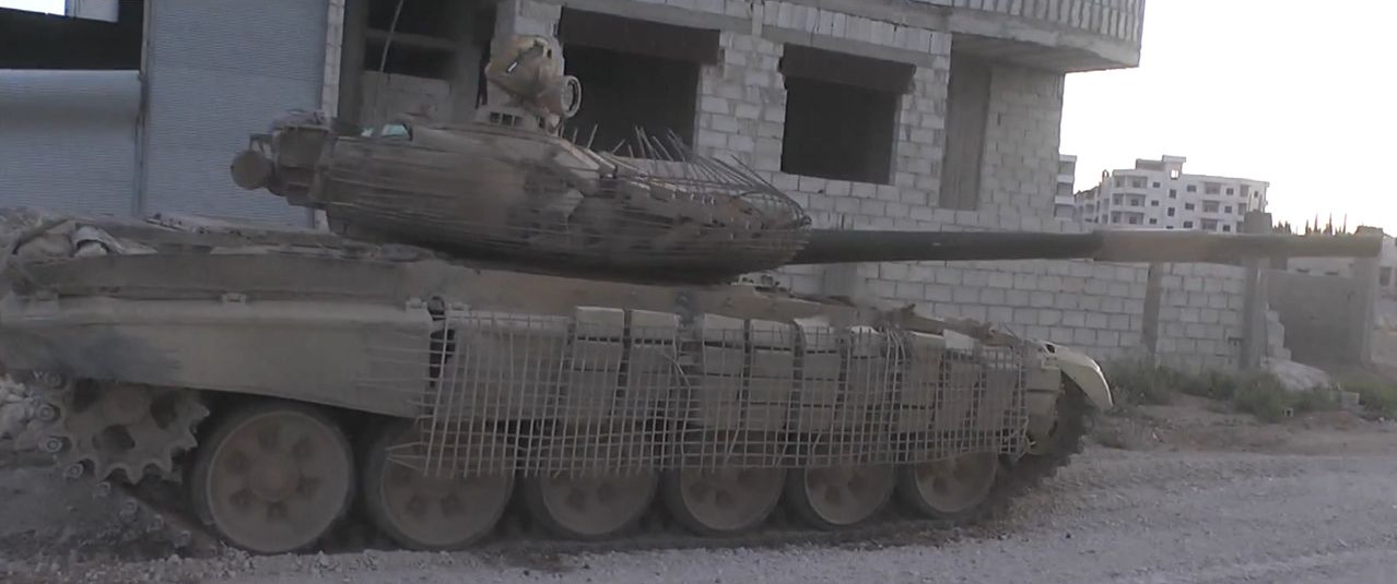 T-72AV with crude cage armor. This was a precursor to the T-72 Mahmia, and often was used to replace lost ERA bricks with construction bricks