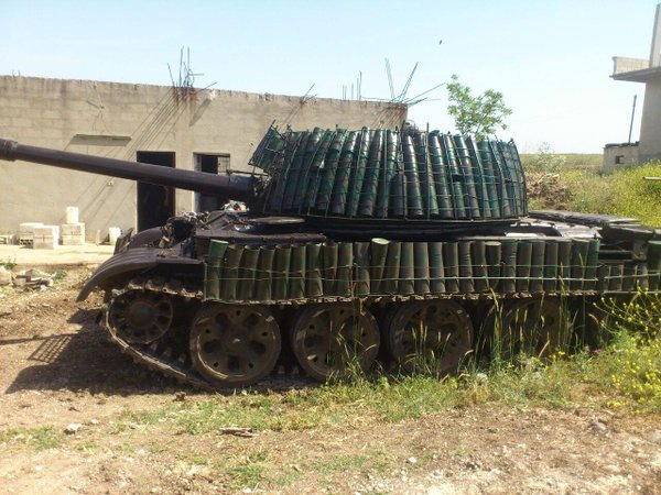 A T-55 fitted with spent shell cases as spaced armor. The effectiveness and reliability of this upgrade is very questionable, but was a precursor to the T-72 Mahmia.
