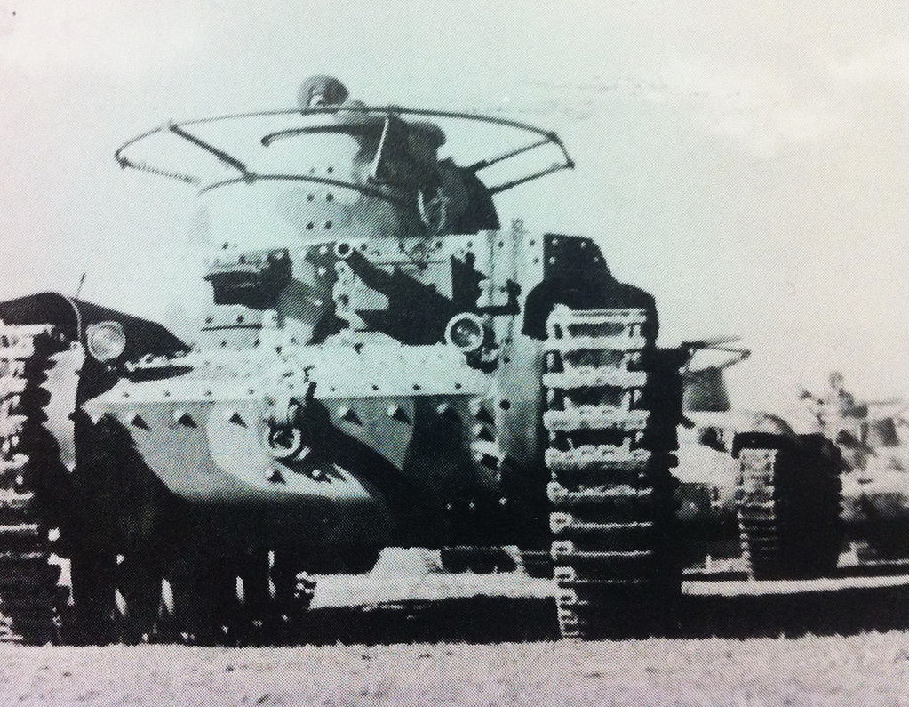 A Shi-Ki leading a column of Chi-Ha tanks. Note the 37 mm gun in the hull and how large the horseshoe antenna was.